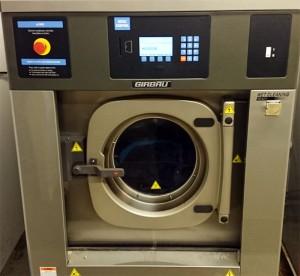 Vaskemaskin for arbeidstøy. Foto. Foto.